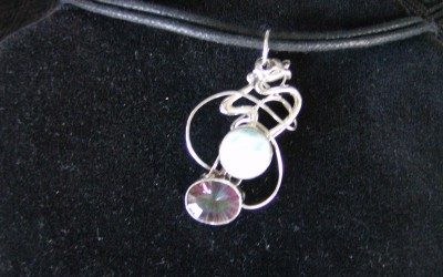 Modern design, sterling silver, larimar and mystic topaz pendant on cotton cord adaptable to chain or omega. SOLD