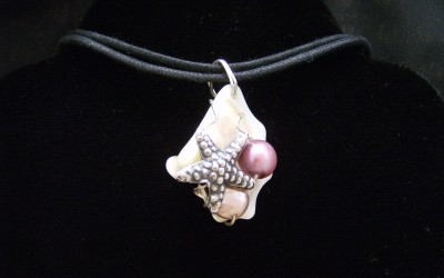 Sea Life, mother of pearl, fresh water pearl, pewter pendant on cotton cord adaptable to chain or omega. SOLD