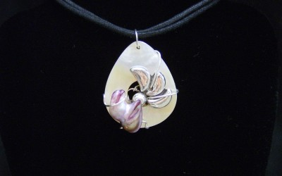 Modern design, sterling silver, Mother of Pearl, baroque pearl pendant on cotton cord adaptable to chain or omega. SOLD