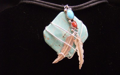 Native design, sterling silver, turquoise, coral & magnesite stone pendant on cotton cord adaptable to chain or omega.$125.00 USD