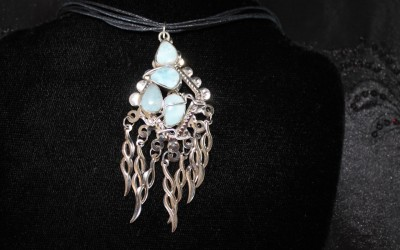 Modern design sterling silver, larimar pendant  on cotton cord adaptable to chain or omega. SOLD
